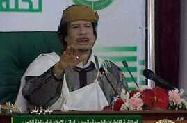 This video image taken from Libyan state television broadcast Wednesday March 2, 2011 shows Libyan leader Moammar Gadhafi addressing supporters and foreign media on Wednesday in a conference hall in the capital Tripoli, Libya
