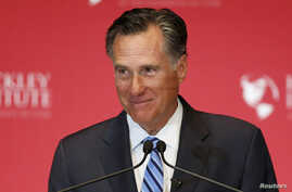 FILE - Former Republican U.S. presidential nominee Mitt Romney pauses and smiles as he delivers a speech criticizing current Republican presidential candidate Donald Trump at the University of Utah in Salt Lake City, Utah March 3, 2016.
