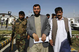 Ziaul Haq Amarkhel , head of Afghanistan's Independent Election Commission, resigned Monday. He's shown leaving a news conference in Kabul, June 23, 2014.