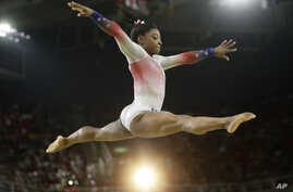 United States' Simone Biles performs on the balance beam during the gymnastics exhibition gala at the 2016 Summer Olympics in Rio de Janeiro, Brazil, Aug. 17, 2016.