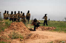 Rebel fighters members of the Liwa Brigade, of which Maher Rahhal was part, are seen training in the northeastern city of Deir Ezzor, on March 25, 2014.