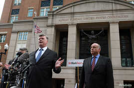 Defense attorneys Richard Westling, (behind microphones), Kevin Downing and Thomas Zehnle speak to the media in front of the U.S. District Courthouse after the verdicts were read in former Trump campaign manager Paul Manafort's trial on bank and tax