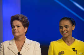 Brazil's President Dilma Rousseff, presidential candidate for re-election of the Workers Party, left, next to Marina Silva, presidential candidate of the Brazilian Socialist Party, as they arrive for a televised presidential debate in Rio de Janeiro,