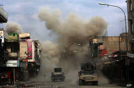 Three roadside bombs laid by Islamic State group militants explode in a western Mosul neighborhood, killing one of the Iraqi engineers attempting to defuse the devices, March 8, 2017.