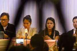 Than Zaw Aung (R), a lawyer of two Reuters journalists, holds a press briefing with Pan Ei Mon (2nd-L), wife of Reuters journalist Wa Lone, Chit Su Win (2nd-R), wife of Reuters journalist Kyaw Soe Oo, and Khin Maung Zaw (L), a lawyer of two Reuters j