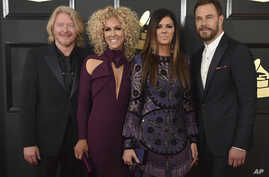 FILE - Philip Sweet, from left, Kimberly Schlapman, Karen Fairchild, and Jimi Westbrook of the musical group Little Big Town attend the 59th annual Grammy Awards in Los Angeles, Feb. 12, 2017.