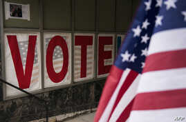 Signage is seen at an early voting center in Minneapolis, Minnesota, Sept. 23, 2016.