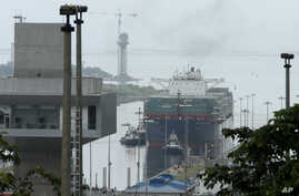 The Neopanamax cargo ship, Cosco Shipping Panama, approaches the new new Agua Clara locks, part of the Panama Canal expansion project, near the port city of Colon, Panama, June 26, 2016.