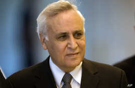 FILE - In this Nov. 10, 2011 file photo, Former Israeli President Moshe Katsav arrives at the Supreme court, in Jerusalem.