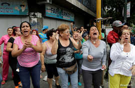 People shout at Venezuelan National Guards (not pictured) during riots for food in Caracas, Venezuela, June 2, 2016.