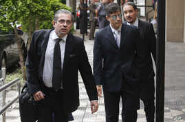 State prosecutors Jose Carlos Blat, left, Cassio Roberto Conserino, center, and Fernando Henrique de Moraes Araujo, responsible for the charges against Brazil's former President Luiz Inacio Lula da Silva, arrive for a press conference at the Attorney
