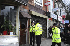 Police outside a property in Birmingham, England, March 23, 2017, following an attack on Wednesday in London.
