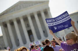 Demonstrator holding up a sign outside the Supreme Court in Washington, June 30, 2014. The Obama administration announced new measures Aug.22 to allow religious non-profits and some companies to opt out of paying for birth control for female employee