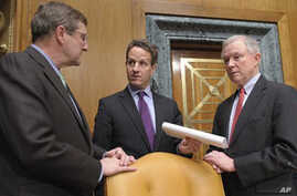 Treasury Secretary Timothy Geithner, center, talks with Senate Budget Committee Chairman Sen. Kent Conrad, D-N.D., left, and the committee's ranking Republican Sen. Jeff Sessions, R-Ala., on Capitol Hill in Washington, Thursday, Feb. 17, 2011.