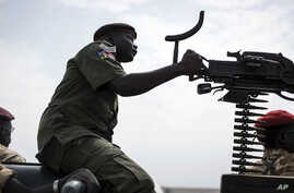 FILE - A government soldier mans a vehicle-mounted machine gun in the oil-rich town of Malakal, South Sudan.