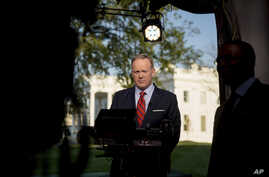 "White House press secretary Sean Spicer prepares to go on cable news on the North Lawn of the White House in Washington, April 11, 2017. Spicer apologized for making an ""insensitive"" reference to the Holocaust in earlier comments about Syrian Preside"