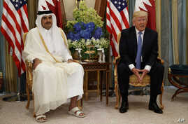 U.S. President Donald Trump, right, holds a bilateral meeting with Qatar's Emir Sheikh Tamim Bin Hamad Al-Thani, in Riyadh, Saudi Arabia, May 21, 2017.