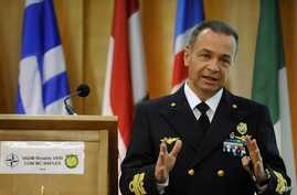 Vice Adm. Rinaldo Veri of Italy speaks during a press conference at NATO's base in Naples, Italy, March 24, 2011.