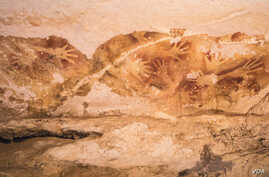 Hand stencils, like the one pictured above from a cave in Sulawesi, are common in prehistoric art. (Credit: Kinez Riza)
