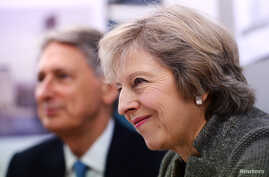 Prime Minister Theresa May and Chancellor of the Exchequer Philip Hammond during a visit to a construction site in Birmingham, where new HSBC offices are being built, Britain, Oct. 3, 2016.