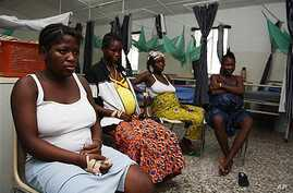 Pregnant women watch television as they wait in the prenatal ward at Princess Christian Maternity Hospital in Freetown, Sierra Leone (2010 File)