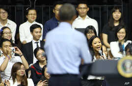 Vietnamese rapper Suboi raps as U.S. President Barack Obama listens at a town-hall style event for the Young Southeast Asian Leaders Initiative at the GEM Center in Ho Chi Minh City, Vietnam on Wednesday, May 25, 2016.