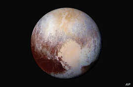 A journey to Pluto reveals a close-up view of mountains of water in frozen fields of nitrogen and methane.