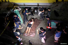 """The body of a man whom police said was killed during a drug bust operation on """"Shabu"""" (Meth), is seen in Manila, Philippines, August 18, 2016."""