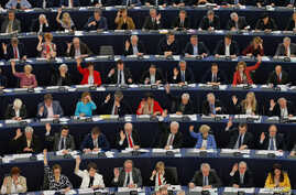 Members of the European Parliament take part in a voting session in Strasbourg, France, April 12, 2016.