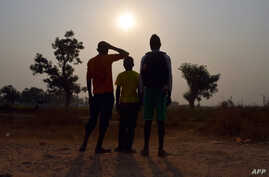 FILE - photo taken on February 11, 2016 shows three children living in the camp for Internally displaced people (IDP) of Mpoko, and claiming to be victims or witnesses of sex abuses on minors by peacekeeper soldiers of the French Sangaris operation,