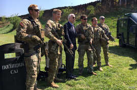 U.S. Senator John McCain poses for a picture with U.S. Green Berets, part on a Joint Combined Exchange Training with Serbia's antiterrorism unit in Belgrade, Serbia, April 10, 2017. (@SenJohnMcCain)