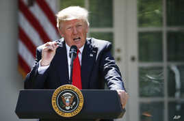President Donald Trump speaks about the U.S. role in the Paris climate change accord, June 1, 2017, in the Rose Garden of the White House in Washington.