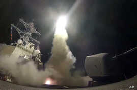 The U.S. Navy guided-missile destroyer USS Porter launches a Tomahawk missile in the Mediterranean Sea, April 7, 2017. The United States blasted a Syrian airfield with a barrage of cruise missiles in fiery retaliation for this week's chemical weapon
