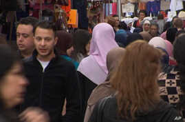Image taken from April 13, 2016 video shows Salah Abdeslam, 2nd left,  the fugitive from the Nov. 13 Paris attacks whose capture appears to have precipitated the March 22 bombing in Brussels.