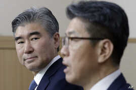 U.S. State Department's Special Representative for North Korea Policy Sung Kim, left, watches as his South Korean counterpart Kim Hong-kyun speaks during a joint press conference after their meeting to exchange views on North Korea's fifth nuclear te