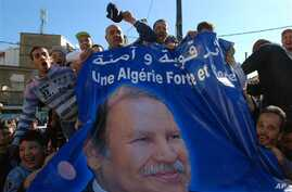 Pro-government protesters display a banner with the picture of Algerian President Abdelaziz Bouteflika in Algiers, March 5, 2011