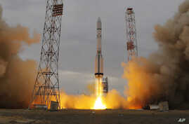 The Proton-M rocket booster blasts off at the Russian leased Baikonur cosmodrome, Kazakhstan, Monday, March 14, 2016.