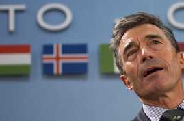 NATO Secretary General Anders Fogh Rasmussen waits for the start of a meeting of the North Atlantic Council at NATO headquarters in Brussels on Tuesday, April 1, 2014