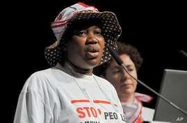 Protesters from No More People Living With HIV Dying From TB movement speak during International AIDS Conference 2010 in Vienna, Austria, 22 July 2010