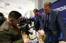 "FILE - A member of the Norh Korean armed forces inspects a submachine gun ""Vityaz-SN"" at the stand of Russian state-owned arms exporter Rosoboronexport during the annual Moscow Conference on International Security (MCIS) in Moscow, Russia, April 4, 2"