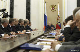 Russian President Vladimir Putin heads a meeting of the Security Council in Moscow's Kremlin July 22, 2014.