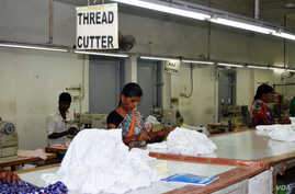 The Trans Pacific Partnership Agreement was also expected to hit export of yarn and textiles. (A. Pasricha/VOA)