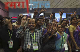 Indian Space Research Organization scientists and other officials cheer as they celebrate the success of Mars Orbiter Mission at their Telemetry, Tracking and Command Network complex in Bangalore, India, Sept. 24, 2014.