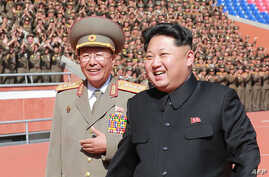 FILE - The man pictured on the left has been identified by South Korea media as Ri Yong-Gil, chief of the Korean People's Army (KPA) General Staff. South Korean media reported on Feb. 10, 2016, as that Ri Yong-Gil was executed, in what would amount t