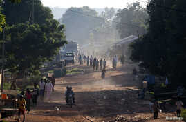 People walk on a main street in Bambari, Central African Republic, May 25, 2014.