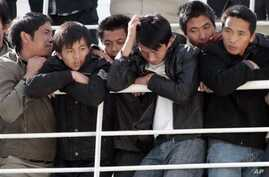 Chinese citizens wait aboard the 'Palermo Grimaldi' ferry at the harbor in Valletta, Malta, after being evacuated from Benghazi, Libya, Feb. 26, 2011.