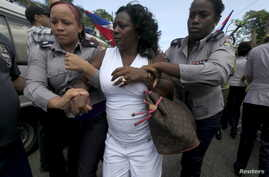 Berta Soler, leader of The Ladies in White, an opposition group, is detained by Cuban security personnel after a weekly anti-government protest march, in Havana, Sept. 13, 2015.