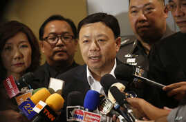 Thailand's National Broadcasting and Telecommunication Commission Secretary-General Takorn Tantasith talks to reporters in Bangkok, Thailand, Tuesday, May 16, 2017.