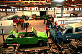 Employees work on a Faoka model of a Karenjy vehicle in an auto plant in Fianarantsoa, Madagascar (file photo - August 24, 2010)