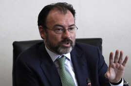 FILE - Mexico's Foreign Relations Secretary Luis Videgaray speaks to the press after meeting with Mexican senators in preparation for a trip to the U.S., where he will participate in talks with members of President Donald Trump's government, in Mexic